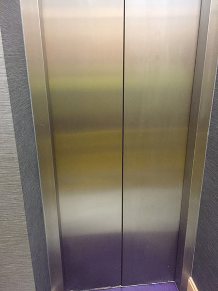 Stainless steel lift door after cleaning